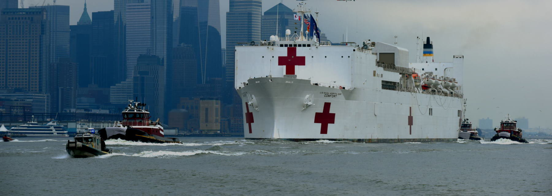 Coast Guard assets, along with New York Police Department and New York Fire Department assets, provide a security escort for the USNS Comfort arrival into New York Harbor, March 30, 2020